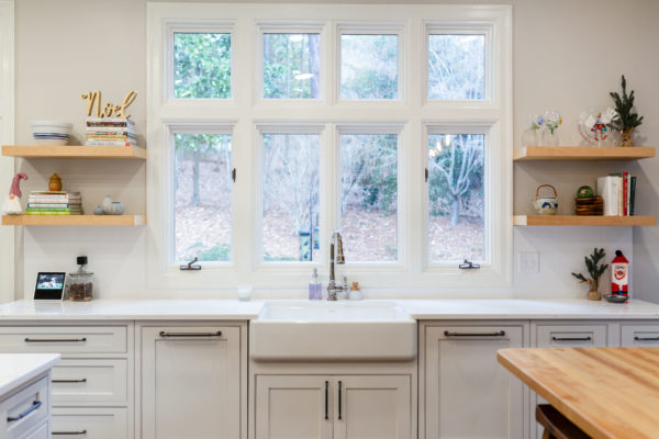 Kitchen remodel project with farmhouse sink. Open concept and natural light, floating shelves and butcher block countertops