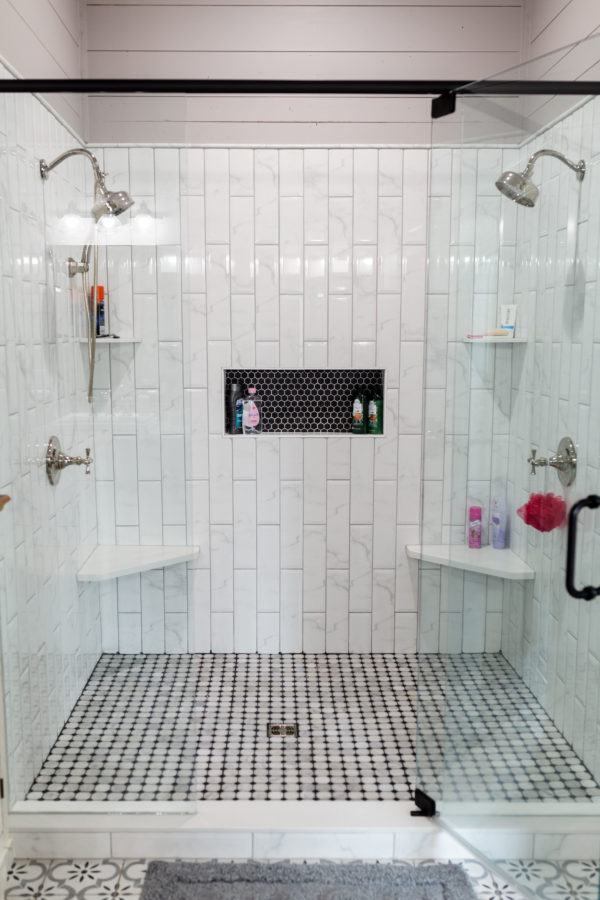 Bathroom reconstruction, upgraded double shower with custom tile work and glass shower door