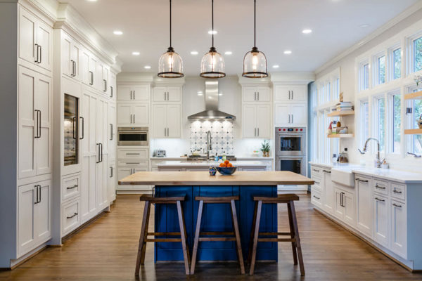 White kitchen cabinets, added kitchen storage, wine fridge, kitchen island and farmhouse sink