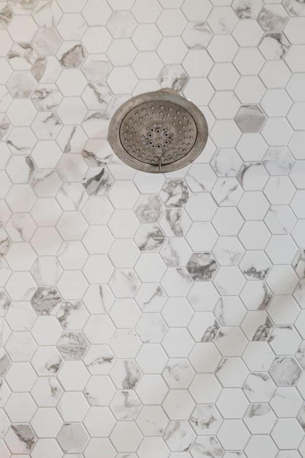 shower remodel. white custom tile work